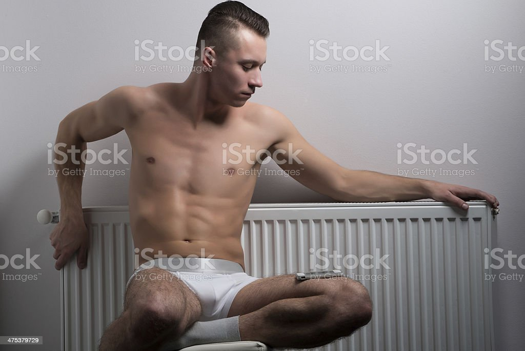 Bask near a radiator stock photo