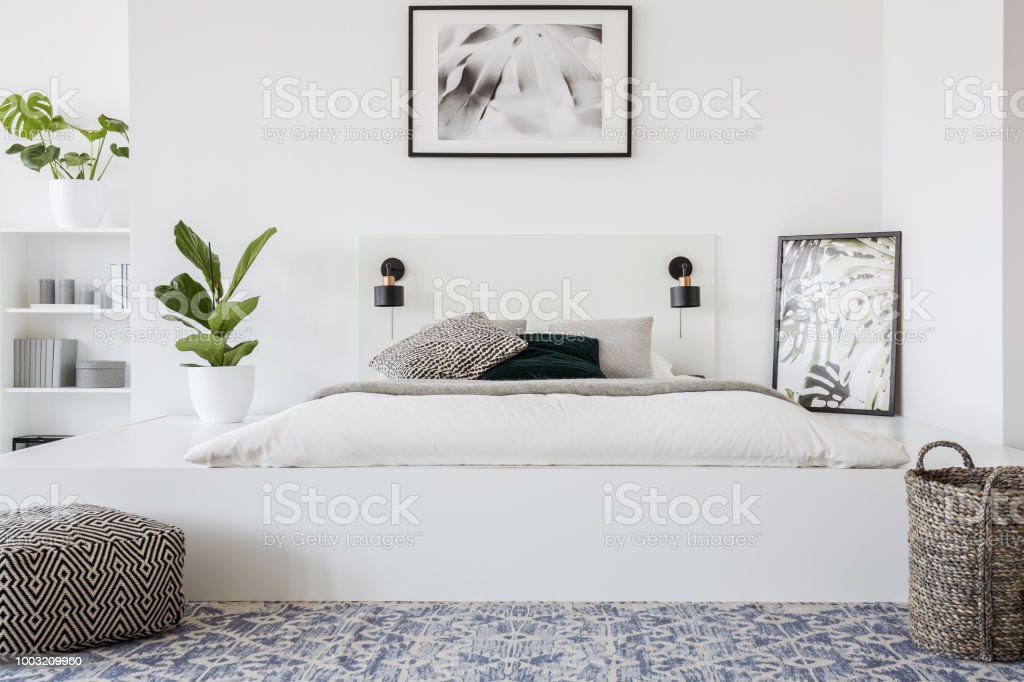 Basket And Pouf In Front Of Bed On Platform In Bright Bedroom Interior With Plant And Poster Real Photo Stock Photo Download Image Now Istock