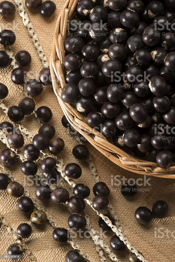 A basket and table full of acai berry fruit royalty-free stock photo