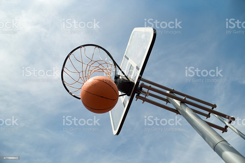 Basket ball in the hoop stock photo