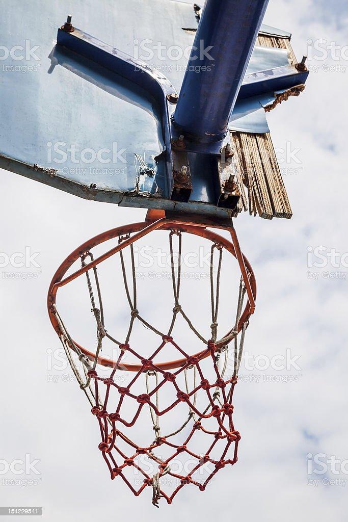 basket ball rim and broken backboard under blue sky royalty-free stock photo