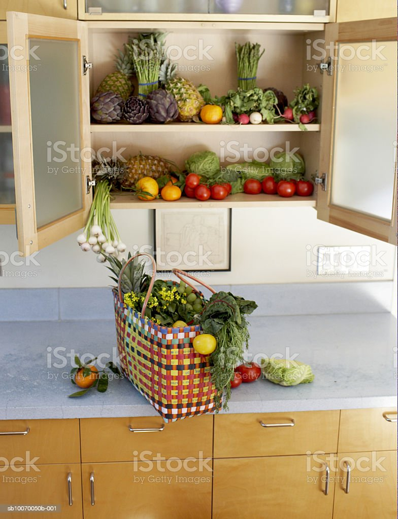 Basket filled with vegetables on kitchen worktop royalty-free stock photo