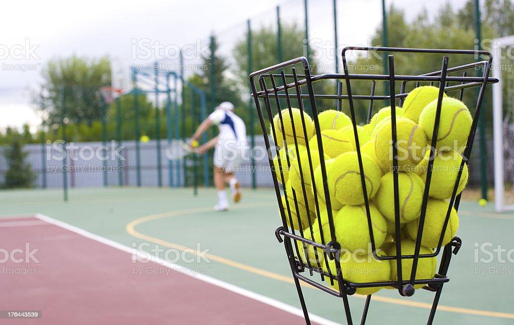basket for tennis balls royalty-free stock photo