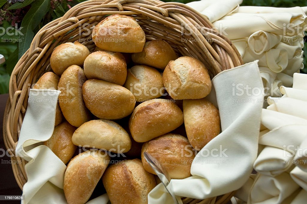 Basket full of bread dinner rolls for a catering event stock photo