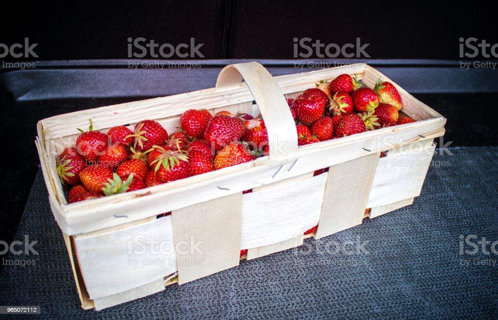 Basket full of fresh strawberries in car trunk zbiór zdjęć royalty-free