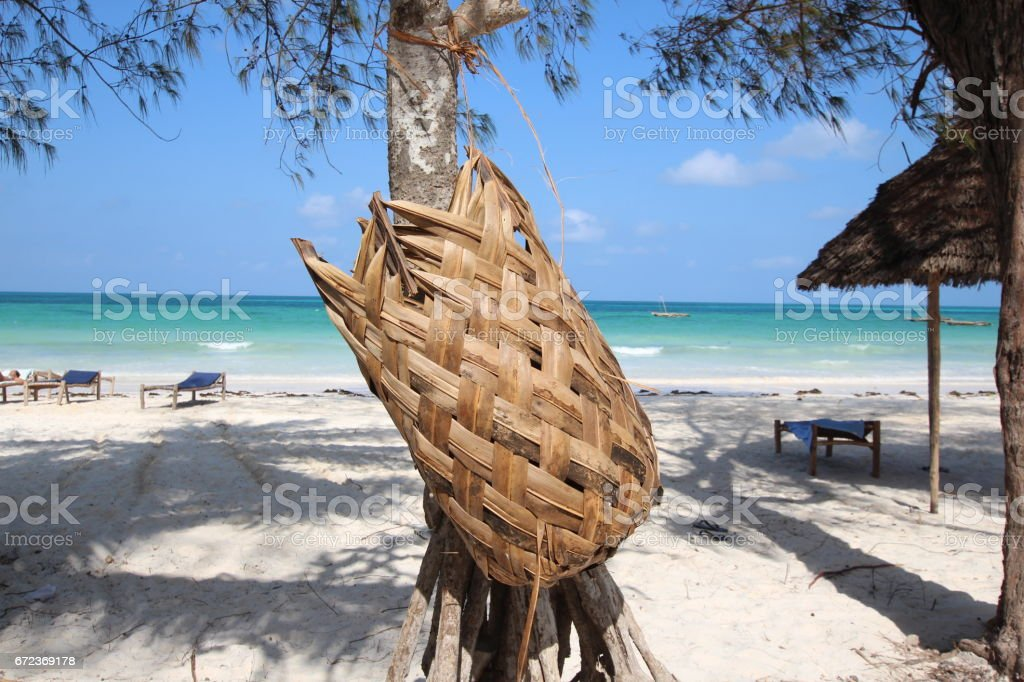 Basket handmade with woven plant leaves, Kiwengwa Beach, Zanzibar, Indian Ocean, Africa stock photo