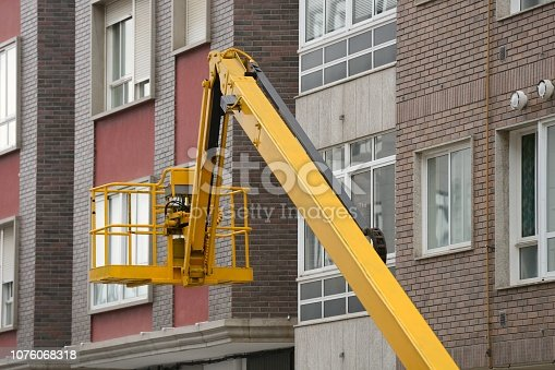 istock basket industrial lift in the background of the building 1076068318