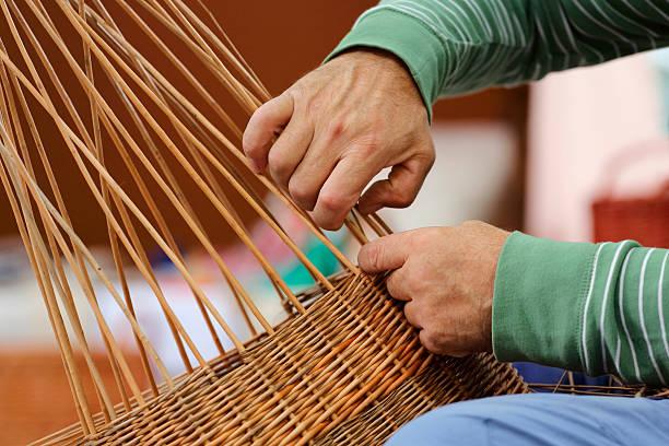 Basket maker Close-up shot of basker maker hands at work craft product stock pictures, royalty-free photos & images