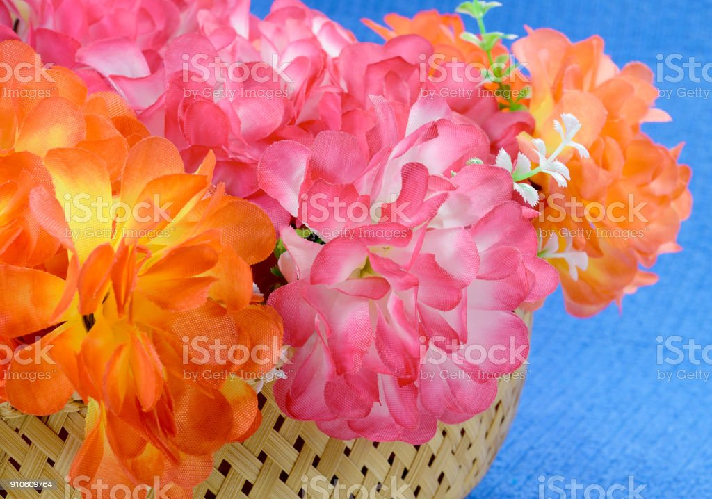 basket of artificial flowers stock photo