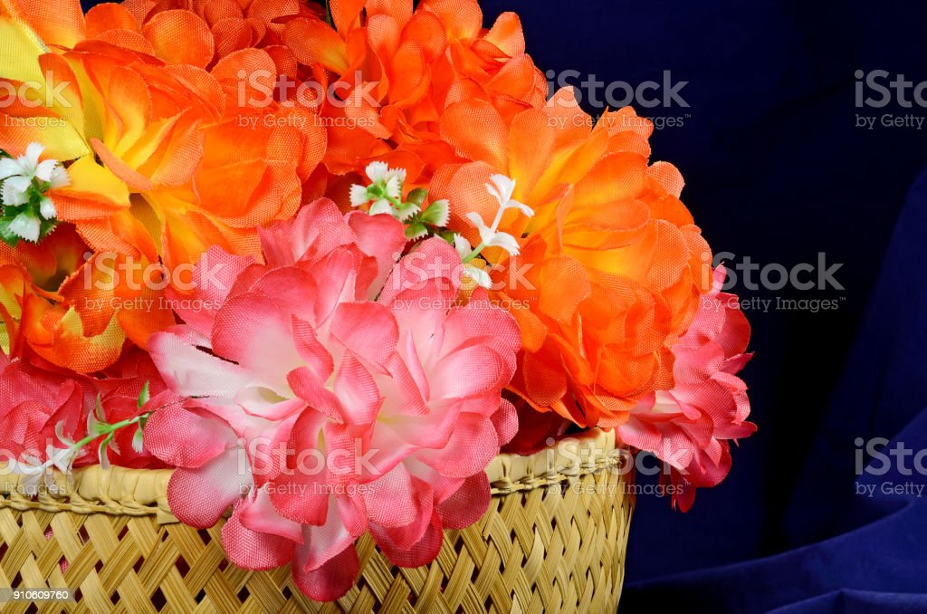 basket of artificial peonies roses stock photo