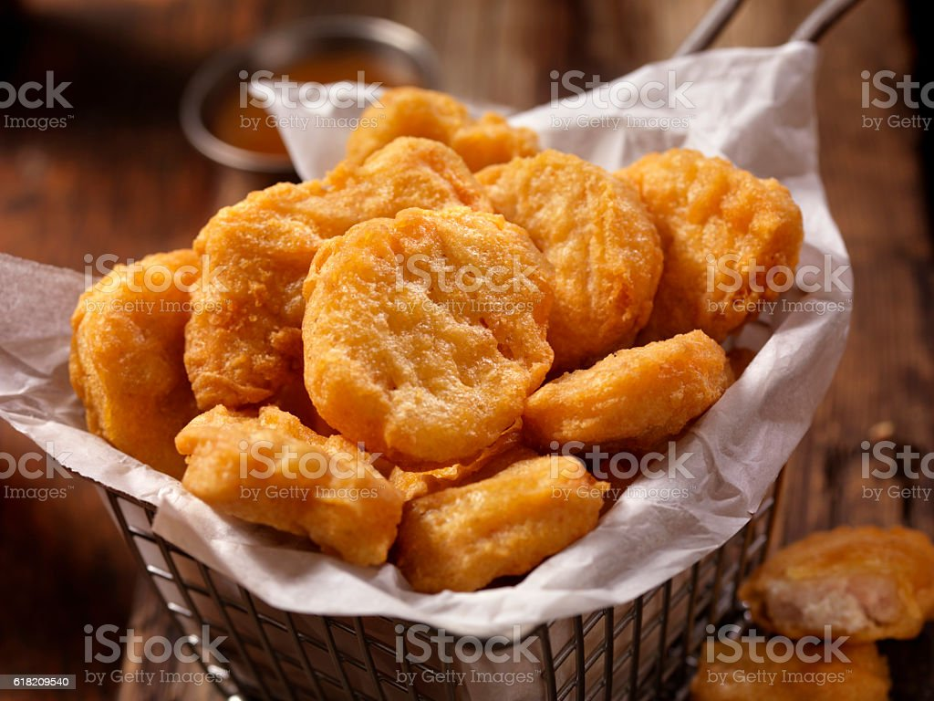Basket of Chicken Nuggets with Sweet and Sour Sauce stock photo