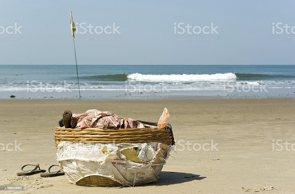 Basket of coconut seller in Vagator beach royalty-free stock photo