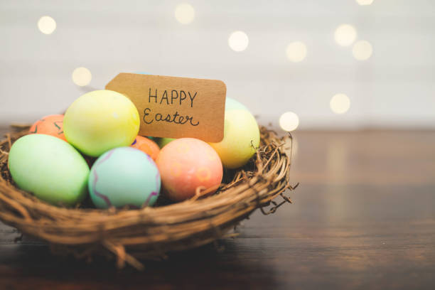 basket of colored easter eggs - easter foto e immagini stock