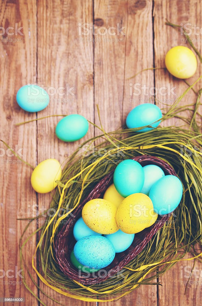 basket of colored eggs, tinted Lizenzfreies stock-foto