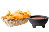 istock Basket of corn chips with salsa, a Mexican appetizer. 184620845