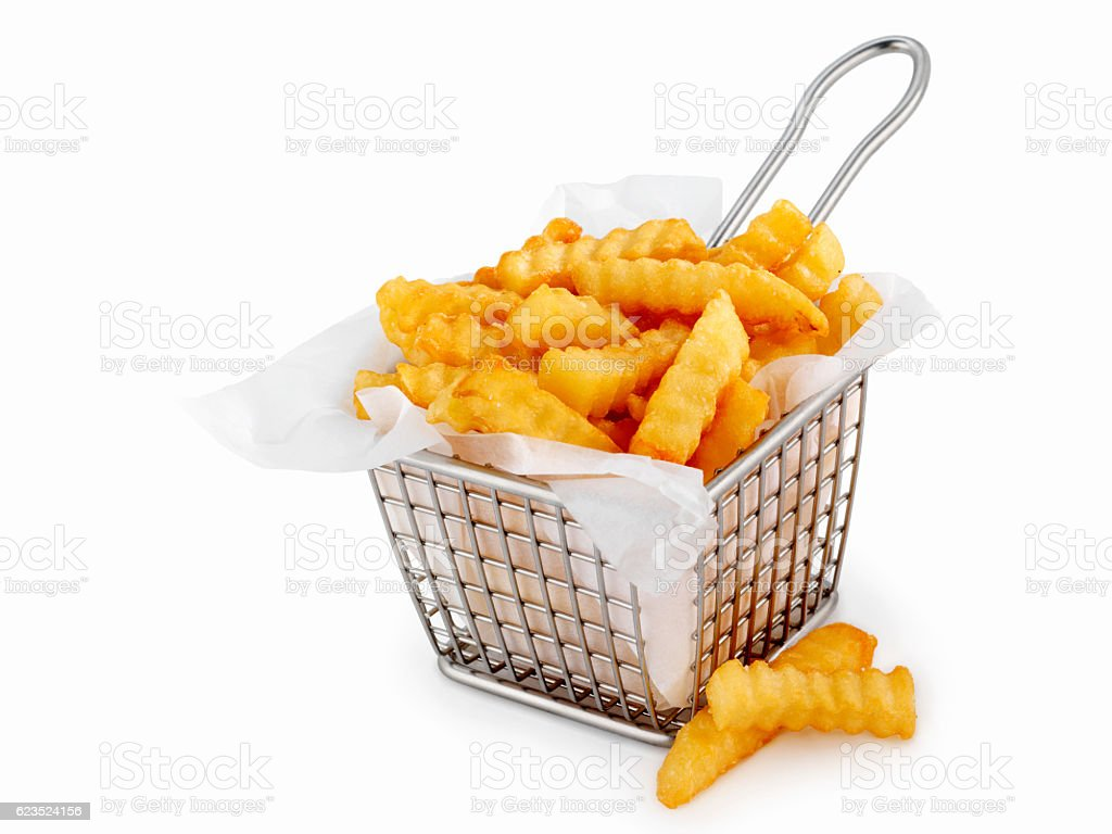 Basket of Crinkle Cut French Fries stock photo