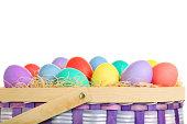 XXXL. Easter basket full of eggs on white.  Good for Easter themed background or border.