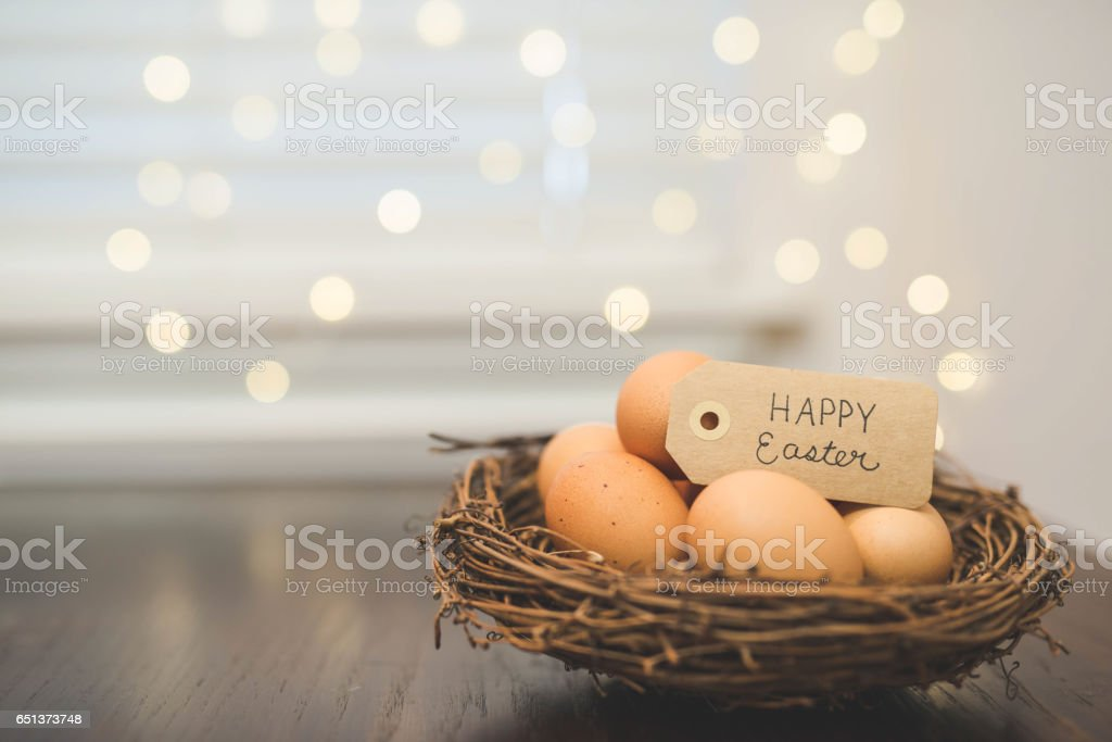 Basket of Easter eggs with sign stock photo