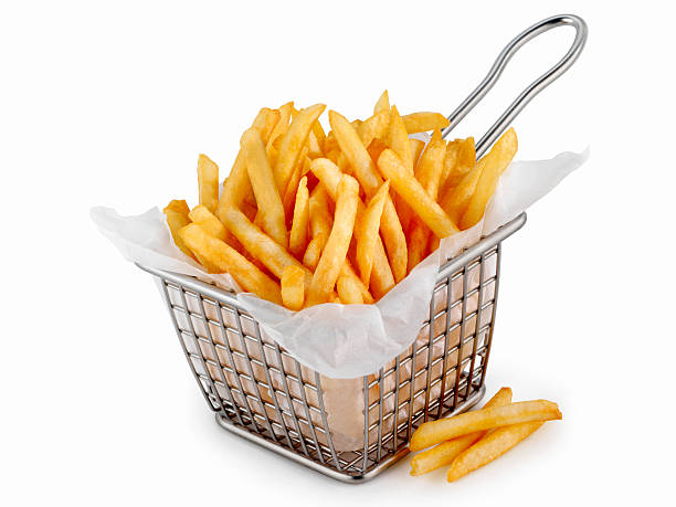 basket of famous fast food french fries - patat stockfoto's en -beelden