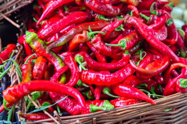 basket of Farmer's market Jimmy Nardello Pepper peppers