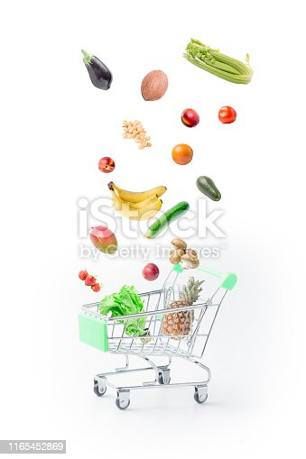 Vegetables and fruits falling into the food basket. Healthy food for every day.