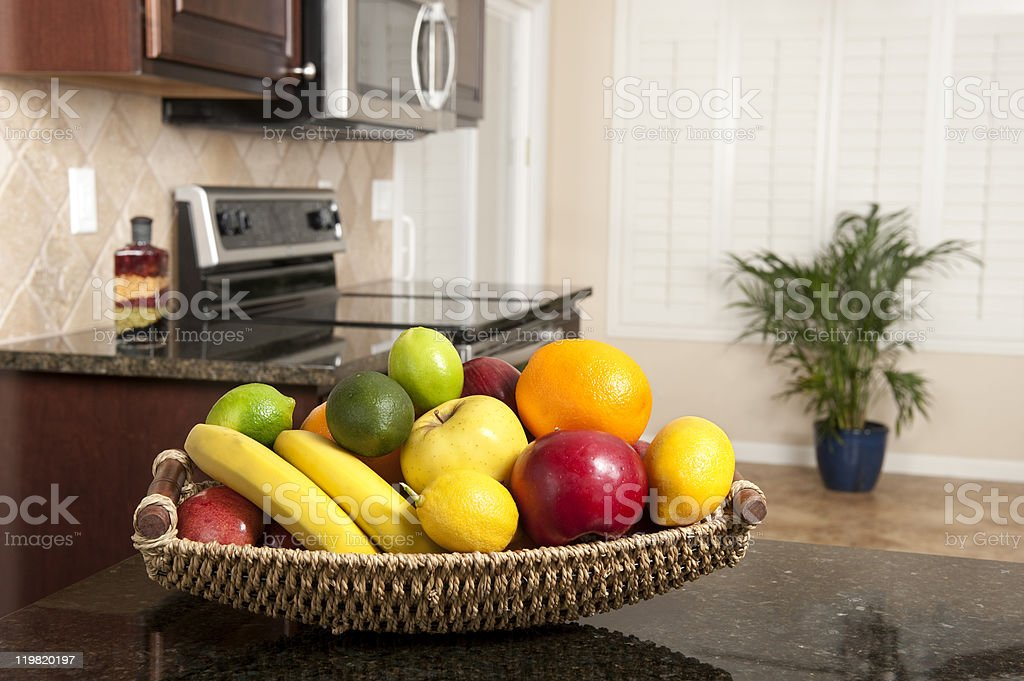 Basket of fresh fruit in modern kitchen stock photo