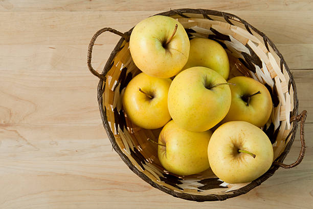 basket of golden delicious apples stock photo