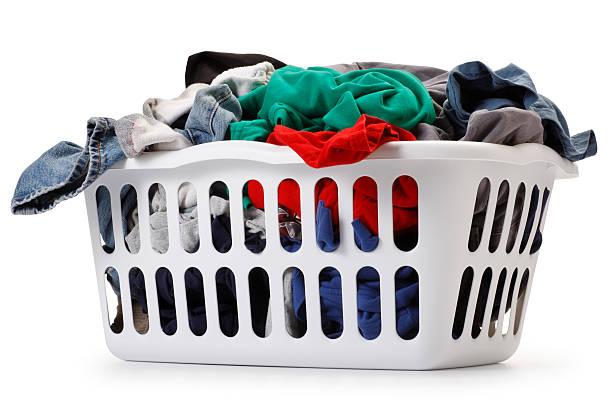 Basket of laundry on white background Basket of Laundry. laundry basket stock pictures, royalty-free photos & images
