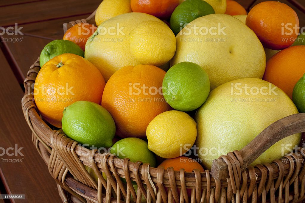 Basket of mixed citrus fruit stock photo
