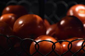 istock A basket of tomatoes- LOW KEY 875759598