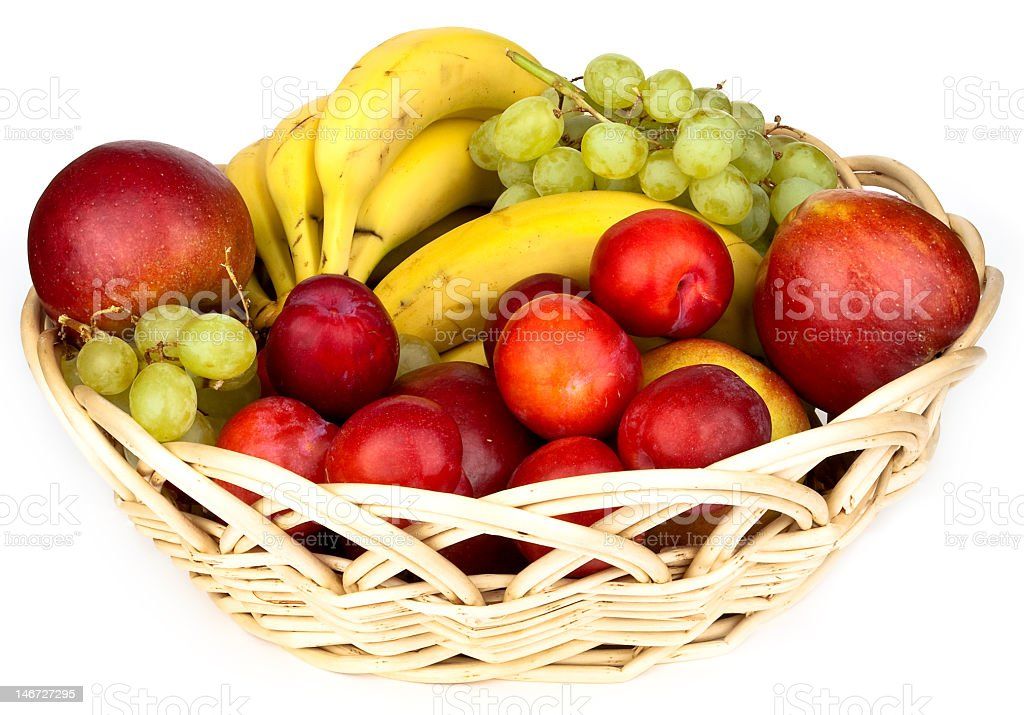 Basket of various fruit and white surface stock photo