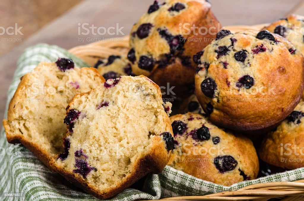 Basket of warm blueberry muffins stock photo