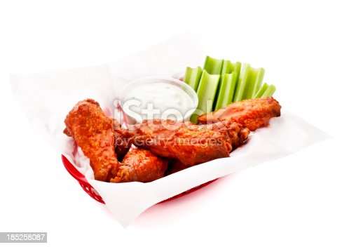 Basket of hot wings with celery and blue cheese dressing.  Please see my portfolio for other hot wing and food related images.