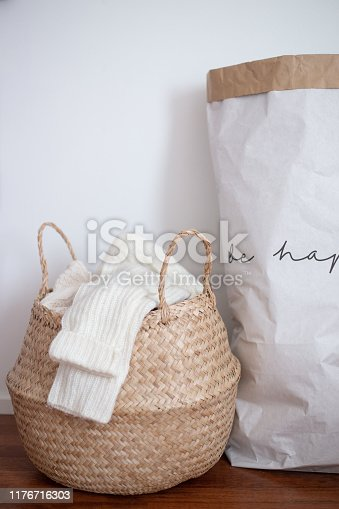 basket of woolen clothes. autumn and winter concept