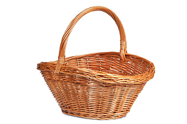 Basket Brown wicker basket isolated on white. wicker stock pictures, royalty-free photos & images