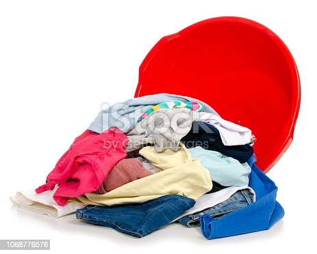 460589747istockphoto Basket plastic basin with clothes laundry 1068776576