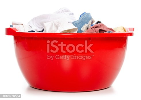 460589747istockphoto Basket plastic basin with clothes laundry 1068776584