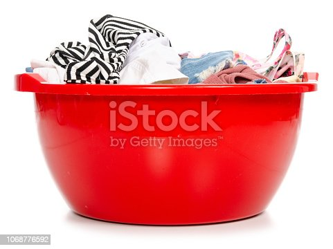 460589747 istock photo Basket plastic basin with clothes laundry 1068776592
