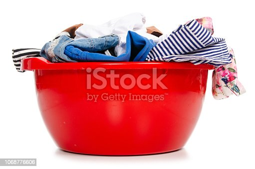 460589747istockphoto Basket plastic basin with clothes laundry 1068776606