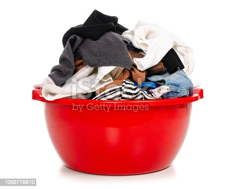 460589747istockphoto Basket plastic basin with clothes laundry 1068776610