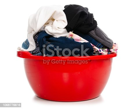 460589747istockphoto Basket plastic basin with clothes laundry 1068776616