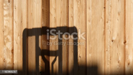 Sunlight basket support shades on the wood wall, Format: 16:9 image. Shot with Nikon D810, ISO 64