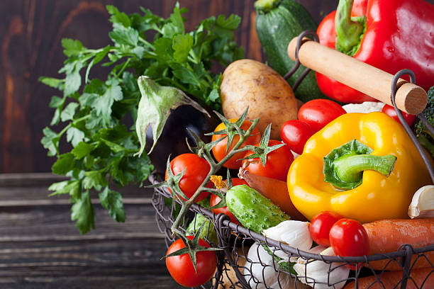 Basket with assortment of fresh vegetables stock photo