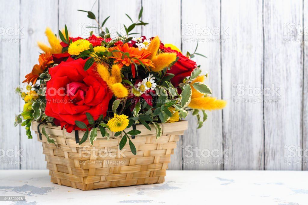 Basket with beautiful bright flowers. Mothers day greeting card stock photo