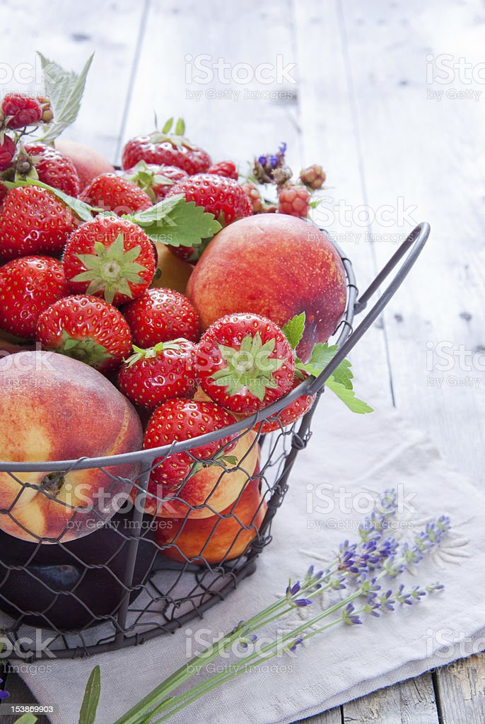 Basket with berries and fruits royalty-free stock photo