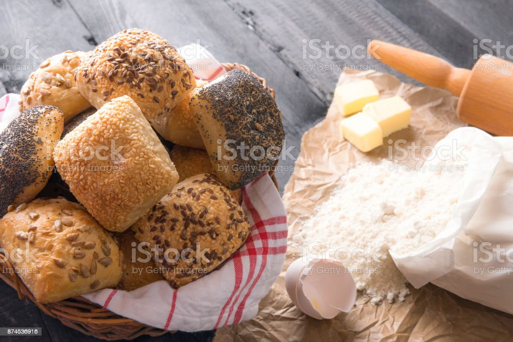 Basket with bread rolls and ingredients stock photo