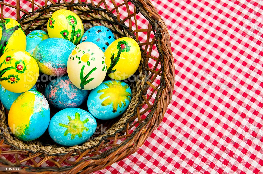 Basket with colorful easter Eggs stock photo