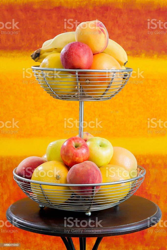 Basket with differents Kinds of Fruits stock photo