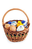 Basket with easter eggs and yellow chicken.