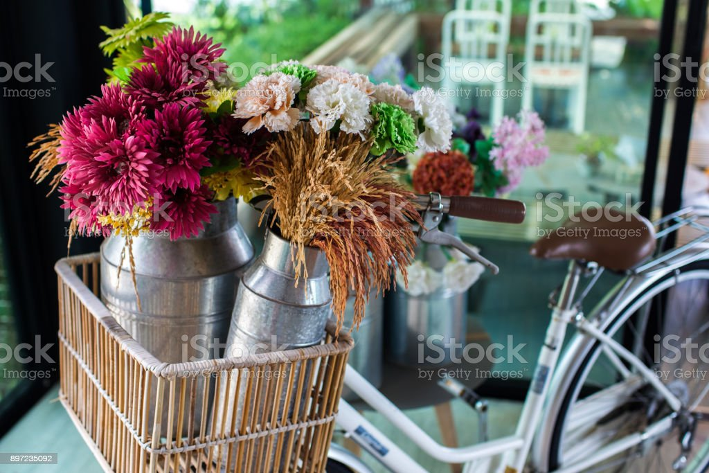 Basket with flowers on vitage city bicycle stock photo